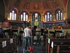 Rob Teehan conducts the small choral ensemble. You can see some of the famous frescos in the chancel.